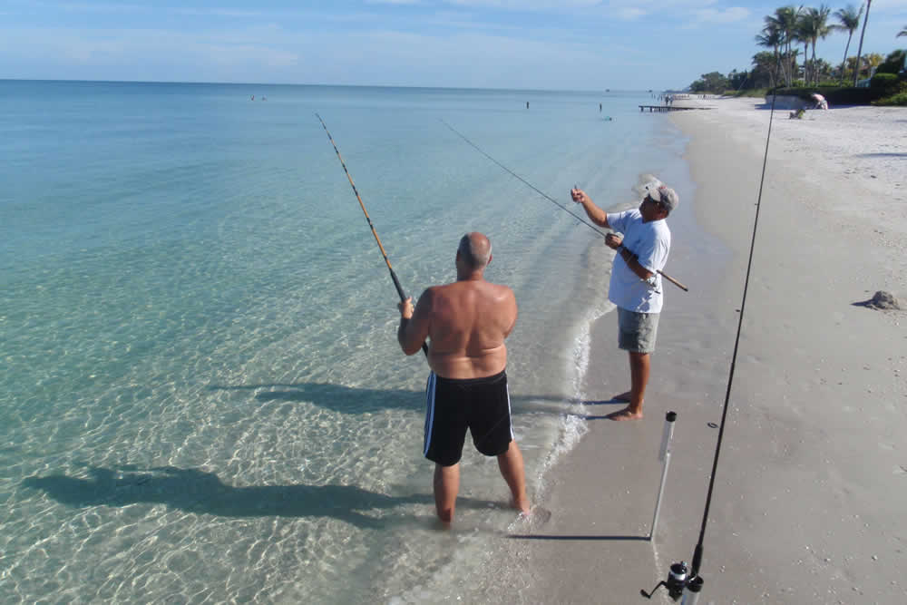 People beach fishing in Naples Florida