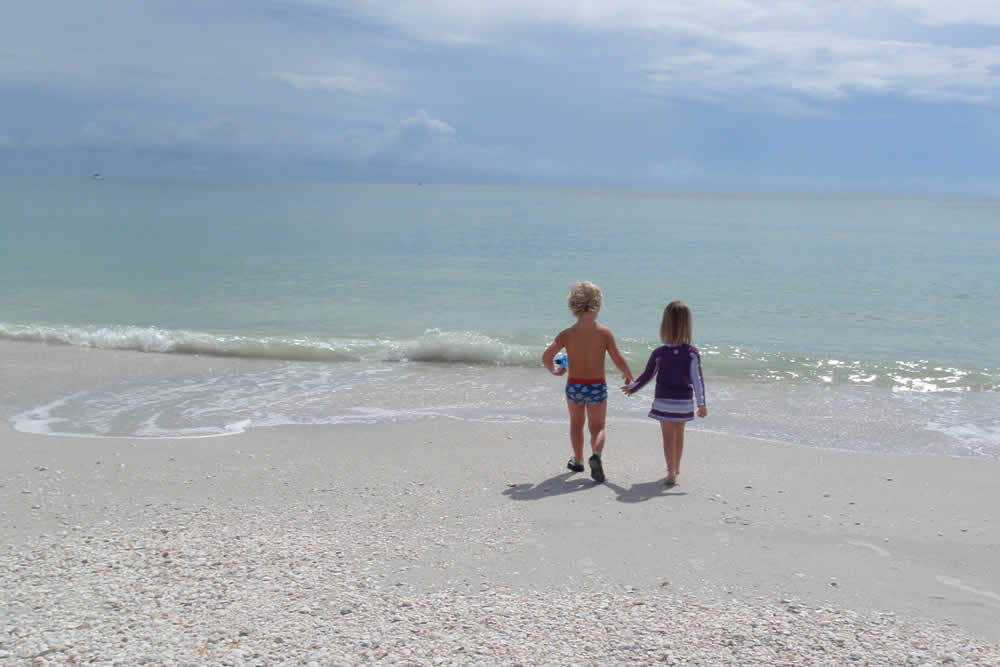 Kids play at the beachin Naples FL