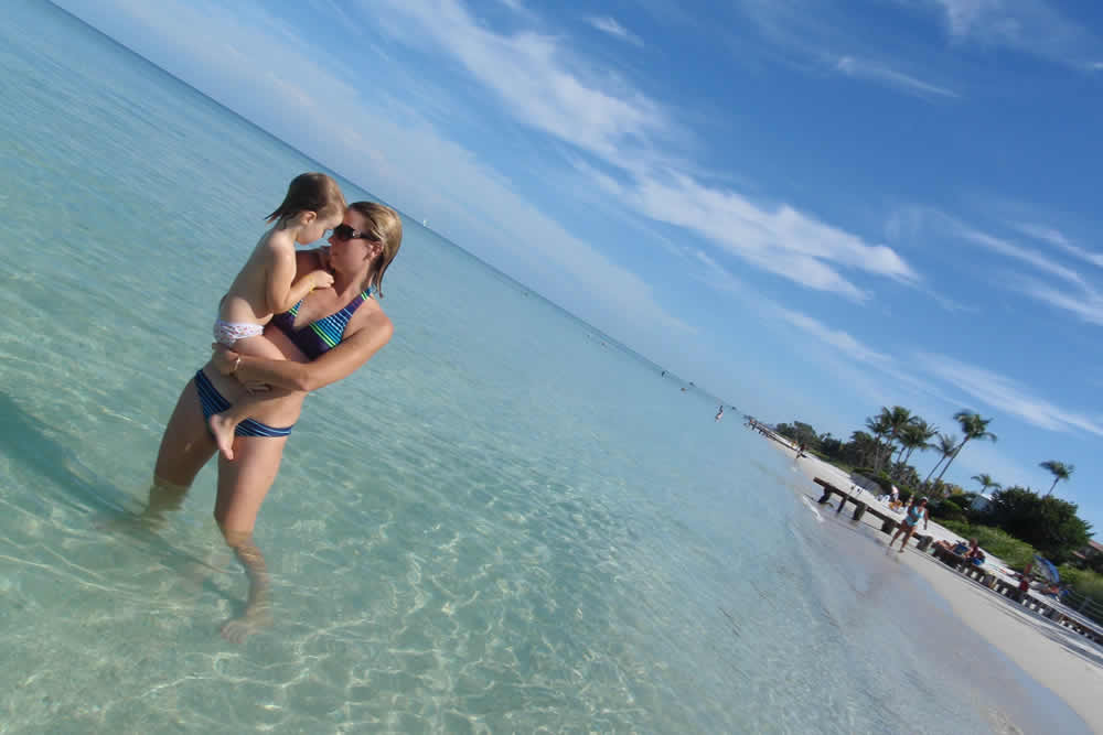 Mother and daughter in the beach in Naples Fl